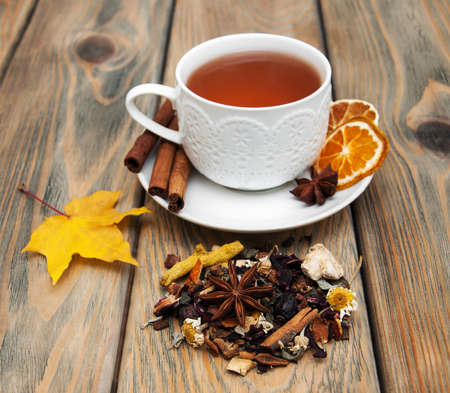 herbal: Cup of winter tea and dry herbal tea on a wooden background Stock Photo