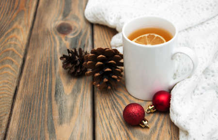 christmas tea: Cup of tea with christmas tree and baubles Stock Photo