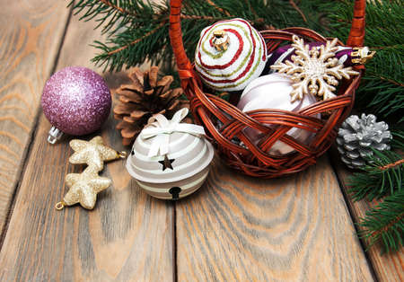 the basket: basket with christmas baubles on a old wooden background