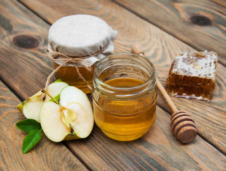 honey comb: honey and apple on a old wooden background Stock Photo