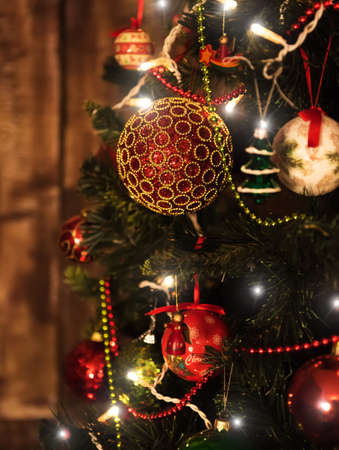 christmas gold: beautiful color christmas decorations hanging on christmas tree