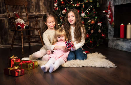 three girls: christmas happy funny children - three  girls hugging