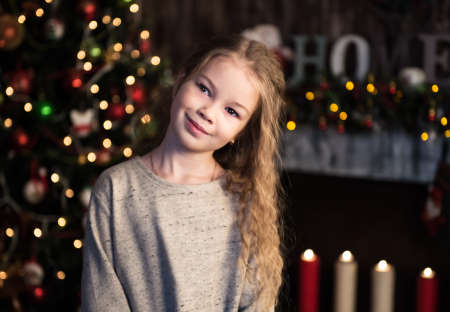 home decorating: little girl near christmas tree in home Stock Photo