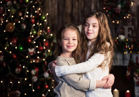 two girls hugging: christmas happy funny children - two girls hugging