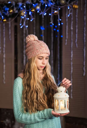 fun background: pretty  girl with flashlight at christmas time Stock Photo