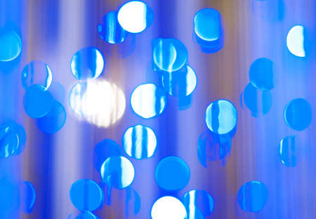 focus: blue festive  abstract background with bokeh lights