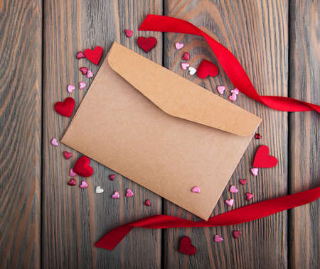 envelope decoration: Envelope with hearts- valentines holiday background