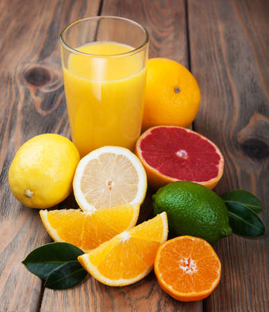 cocktails: Fresh citrus juice with fruits on a wooden table Stock Photo