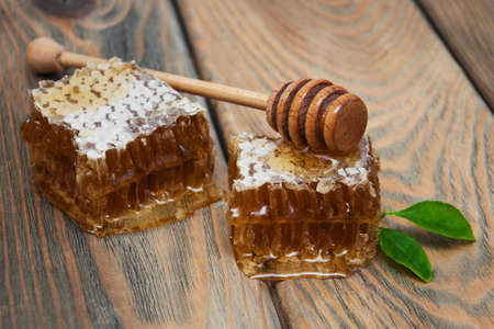 honey comb: Honey comb on a old wooden background Stock Photo