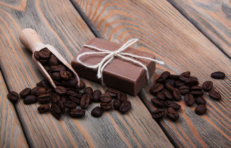 scented soap: handmade coffee scented soap on wooden background