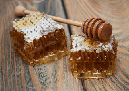 comb: Honey comb on a old wooden background Stock Photo