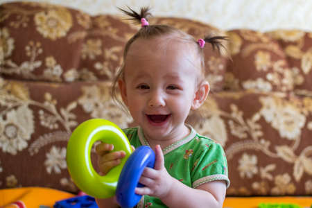 Cute little girl with two pigtails laughing. Laughing little girl Stock Photo