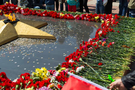 Flowers to the eternal fire. Celebration of Victory Day. Russia, Chita