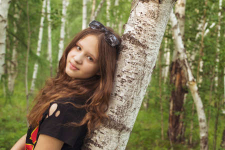 portrait of young woman in forest
