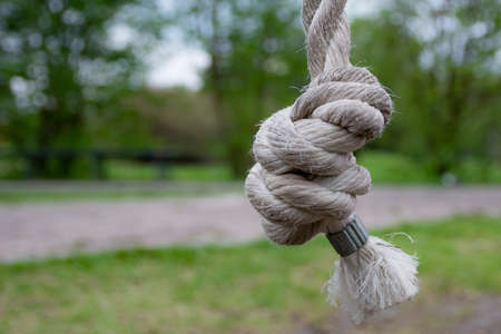 Rope knot tied together as a symbol for trust and faith and a metaphor for strength or stress. Standard-Bild
