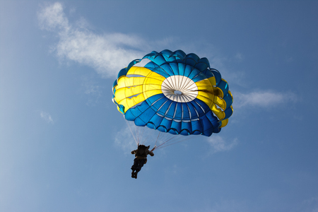 Parachute on background blue sky. Stock Photo
