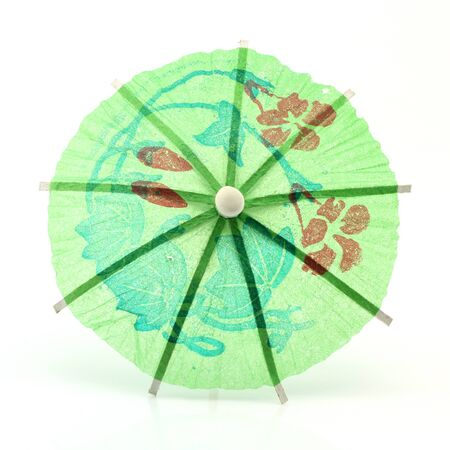 green cocktail umbrella isolated on white background