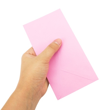 Hand Holding A Pink Envelope On White Background  Stock Photo