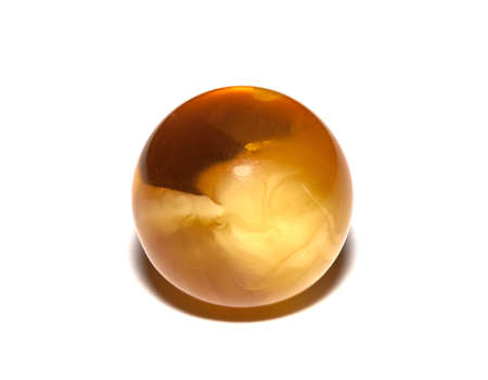 Amber spheres on a white table. Baltic sea