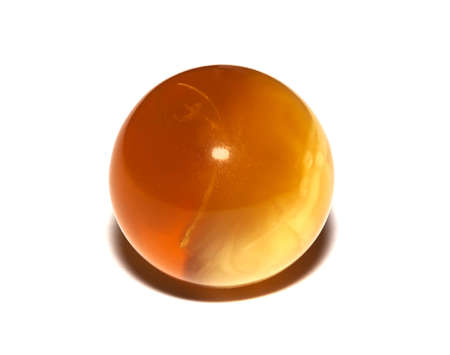 amber coloured: Amber spheres on a white table. Baltic sea Stock Photo