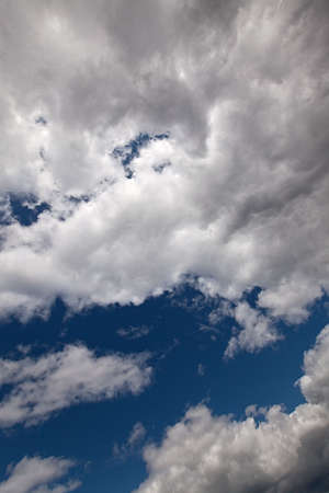 The dark blue sky with cumulus clouds Stock Photo