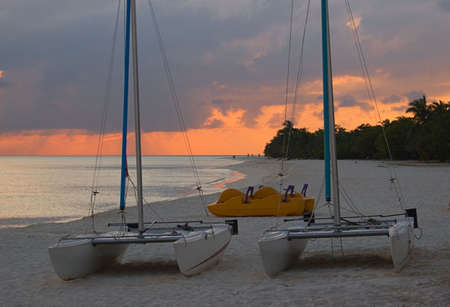 Boats on coast of ocean