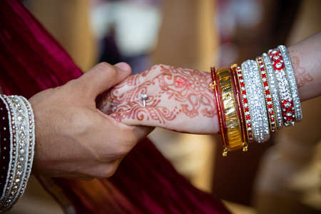 asian bride: Holding hands