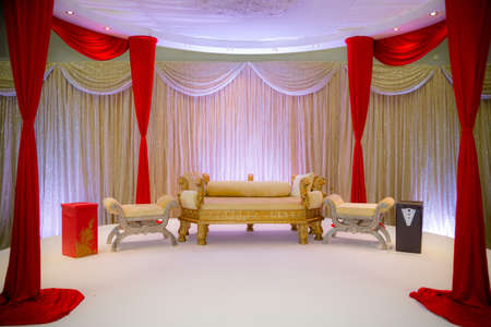 wedding: Red and gold themed asian wedding stage Stock Photo