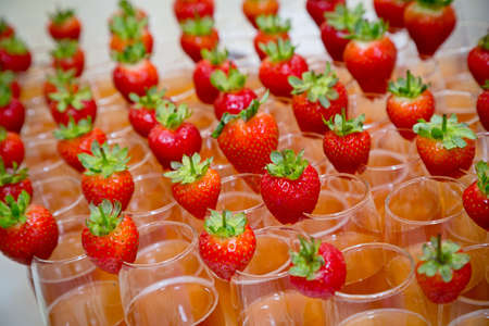 banqueting: Strawberries on top of mocktails Stock Photo