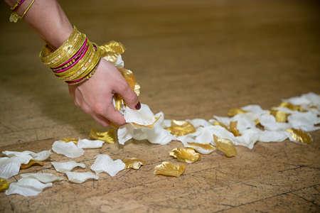 bangles hand: Putting the petals down