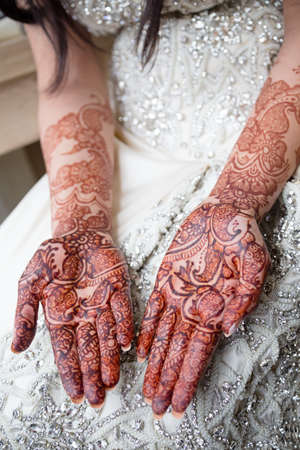 henna tattoo: Palms of brides henna tattoo Stock Photo