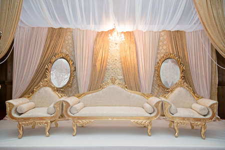 wedding backdrop: Gold themed Indian wedding stage