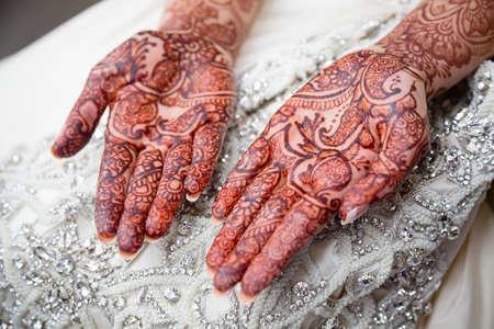 Bridal henna on brides wedding day Stock Photo
