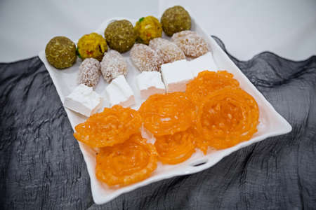 indian sweet: Indian sweets on a tray Stock Photo