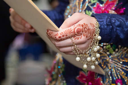 hand holding paper: Henna hand holding paper focus on henna