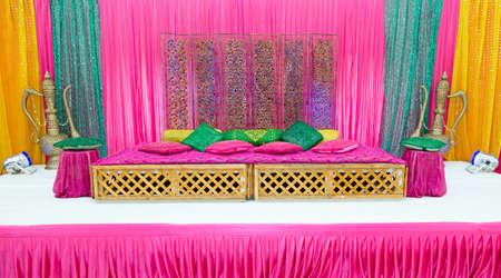 wedding backdrop: Colourful henna party wedding stage Stock Photo