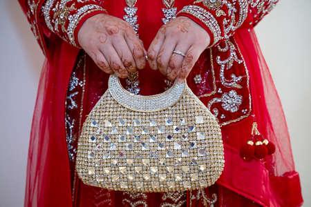 clutch bag: bride holding her clutch bag