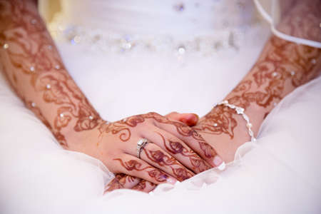 henna: brides hands in henna with ring