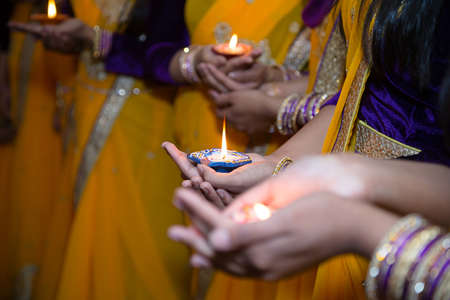 divali: Girls holding candles for henna party