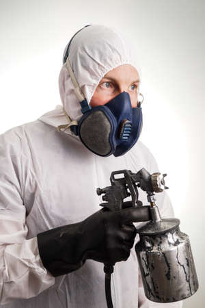 Man in protective suit, gloves, paintpistol and a respiraton