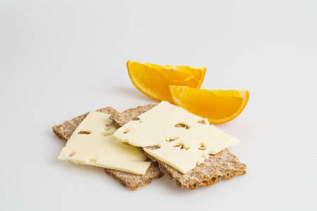 Crispy rye bread with cheese and orange photo