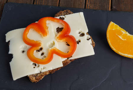 wholemeal rye bread with cheese and orange photo