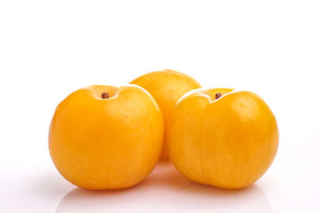 Fresh healthy Yellow plum isolated on white