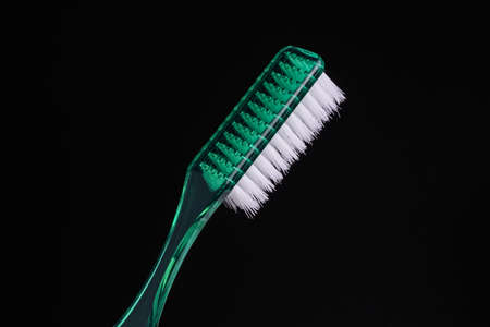 cope: Green Toothbrush isolated on Black with cope space Stock Photo