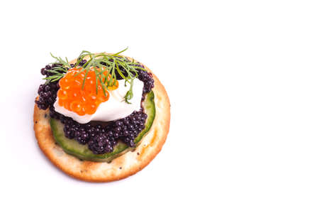 Caviar Appetizer served on crackers isolated on white