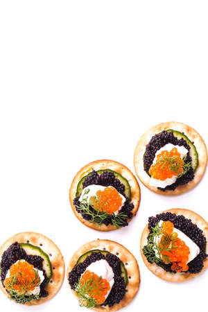 Caviar Appetizer served on crackers isolated on white photo