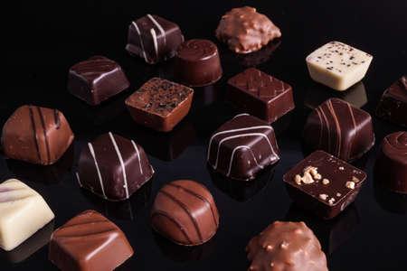 praline: Delicious praline Dessert Chocolate on Black background