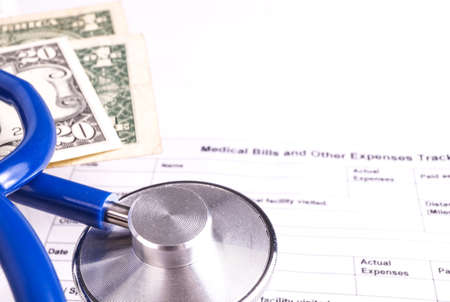 Medical Bill Statement with Stethoscope and Money, All text is anonymous. The Stephoscope is Blue. Hospital Bill Banco de Imagens