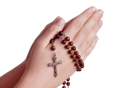 Hands of a woman Praying with Rosary isoalted on white