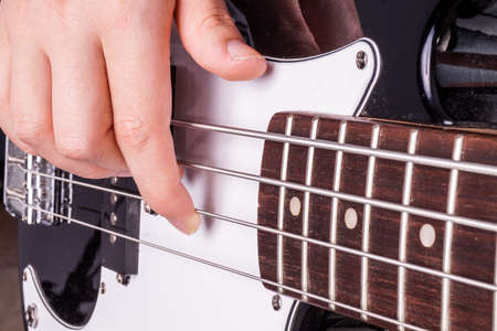 rock guitarist: Hands of an female teenager plays guitar, Isolated on white